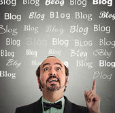 Man has idea pointing looking up copy space with blog words  — Stock Photo