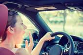 Tired, fatigued, exhausted young attractive woman driving her car — Stock Photo