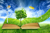 Green micro world, book covered with green grass wind energy turbines — Foto Stock