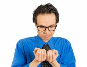 Crazy perfectionist man with black glasses anxiously looking at fingernails — Stockfoto