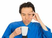 Tired falling asleep young businessman holding cup of coffee — 图库照片