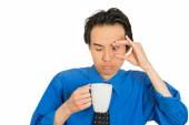 Tired falling asleep young businessman holding cup of coffee — ストック写真