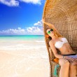 Woman young lady with sunglasses relaxing on the tropical beach — Stock Photo #60940521