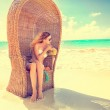 Woman young lady with sunglasses relaxing on the tropical beach — Stock Photo #60940675