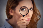 Headshot woman investigator looking through magnifying glass — Stock Photo