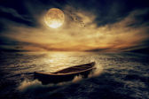 Boat drifting away from past in middle of ocean after storm without course — Stock Photo