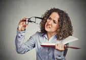 Woman can't see read book has vision problems wrong glasses  — Stock Photo