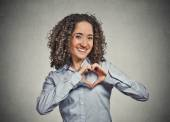 Smiling cheerful happy young woman making heart sign with hands — Stock Photo