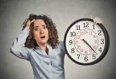 Stressed corporate employee holding clock looking anxiously running out of time — Stock Photo