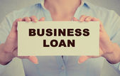 Business woman hands holding card sign with business loan message  — Stock Photo
