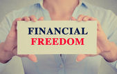 Businesswoman hands holding card sign with Financial freedom message  — Stock Photo