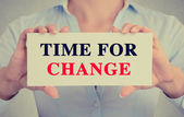 Businesswoman hands holding card sign with time for change message  — Stock Photo