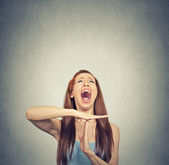 Young woman showing time out hand gesture, frustrated screaming — Stock Photo