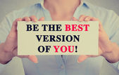 Businesswoman hands card sign with be the best version of you message — Stock Photo