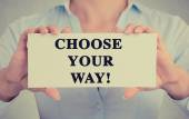 Closeup businesswoman hands holding sign with choose your way message — Stock Photo