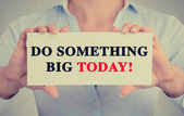 Businesswoman hands holding sign with do something big today message — Stock Photo