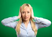 Woman covering her ears avoiding unpleasant rude situation — Stock Photo