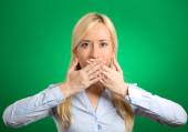 Woman covering closed mouth with hands — Stock Photo