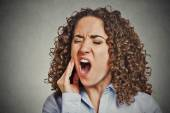 Woman with sensitive tooth ache crown problem — Stock Photo