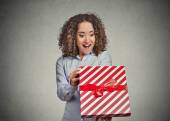 Happy woman opening unwrapping red birthday gift box — Stock Photo