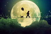Teenager and cat walking with balloon on tight rope above clouds — Stock Photo
