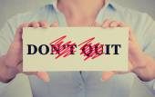 Closeup hands sign don't quit do it message — Stock Photo