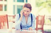 Stressed worried business woman talking on mobile phone — Stock Photo