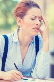 Stressed professional woman sitting outside corporate office — Stockfoto