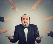 Accusation of guilty arrogant businessman who shrugs shoulders  — Stock Photo