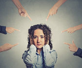 Concept accusation guilty woman many fingers pointing at her — Stock Photo