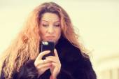Upset skeptical unhappy woman talking texting on mobile phone — Foto de Stock
