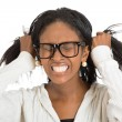 Frustrated stressed woman with glasses pulling her hair out — Stock Photo #68023945