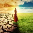 Climate Change Concept Woman walking through opened field — Stock Photo #68027103