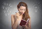 Portrait beautiful girl thinking planning writing down notes  — Zdjęcie stockowe