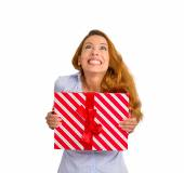 Super excited funky woman with gift box looking up white background — Stock Photo