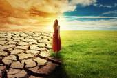 Climate Change Concept Woman walking through opened field  — Stock Photo