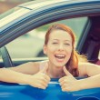 Woman driver happy smiling showing thumbs up sitting inside new car — Stock Photo #68434521