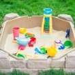 Child playground with Sandbox and toys in a backyard — Stock Photo #68435095