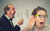 Angry man screaming in megaphone curious nosy woman listening   — Stock Photo