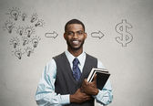 Man holding books has ideas ready for financial success — Stockfoto