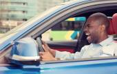 Angry pissed off aggressive young man driving car shouting — Stock Photo