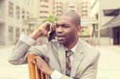 Unhappy upset sad, skeptical man talking on phone — Stock Photo