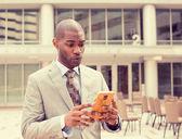 Sad skeptical unhappy serious man talking texting on phone — Stock Photo