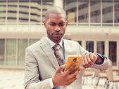 Business man looking at mobile phone watch running out of time  — Stock Photo