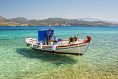 Moored fishing boat in the clear sea water — Foto Stock