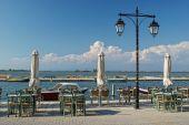 A Greek taverna on the sea pier — Stock Photo