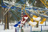 The old carousel in the winter forest. — Stock Photo