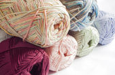 Colours of yarns in white background — Stock fotografie