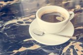 Black coffee on black mable — Stock Photo