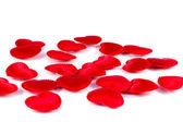 Beyaz zemin üzerine birkaç küçük kırmızı kalpler doku — Stok fotoğraf